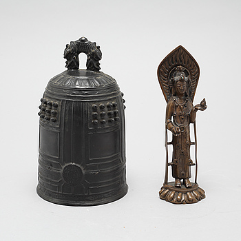 A Chinese temple bell and a figure of a deity, 20th Century.