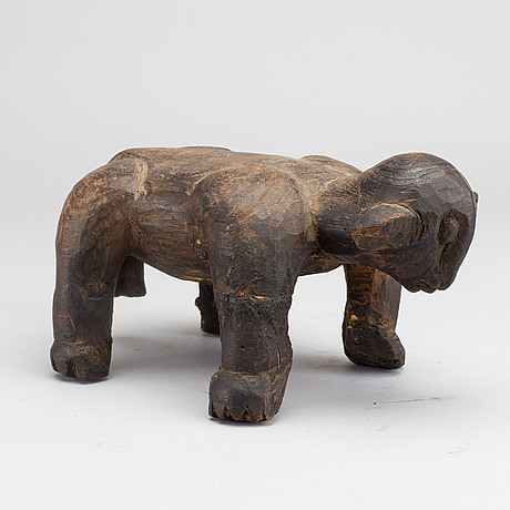 A animal shaped stool. west africa