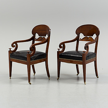 EMPIRE, A pair of early 19th century mahogany  Empire armchairs, presumably from the Baltic countries.