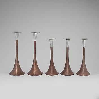 A SET OF FIVE METAL CANDLESTICKS, second half of the 20th century.