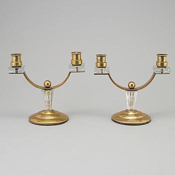 ART DÉCO, A pair of art déco brass and glass candelabra.