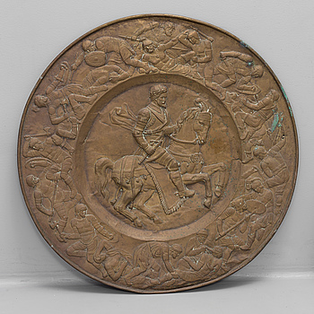 A BRASS WALL PLAQUE, 19th century.
