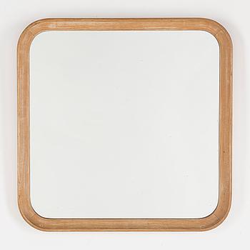 A 1960s oak mirror.