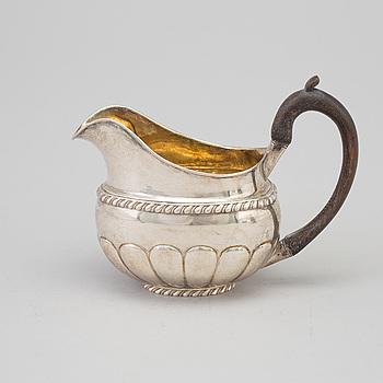 A Russian parcel-gilt cream jug, maker's mark Erik Frisk, St Petersburg, 1826.