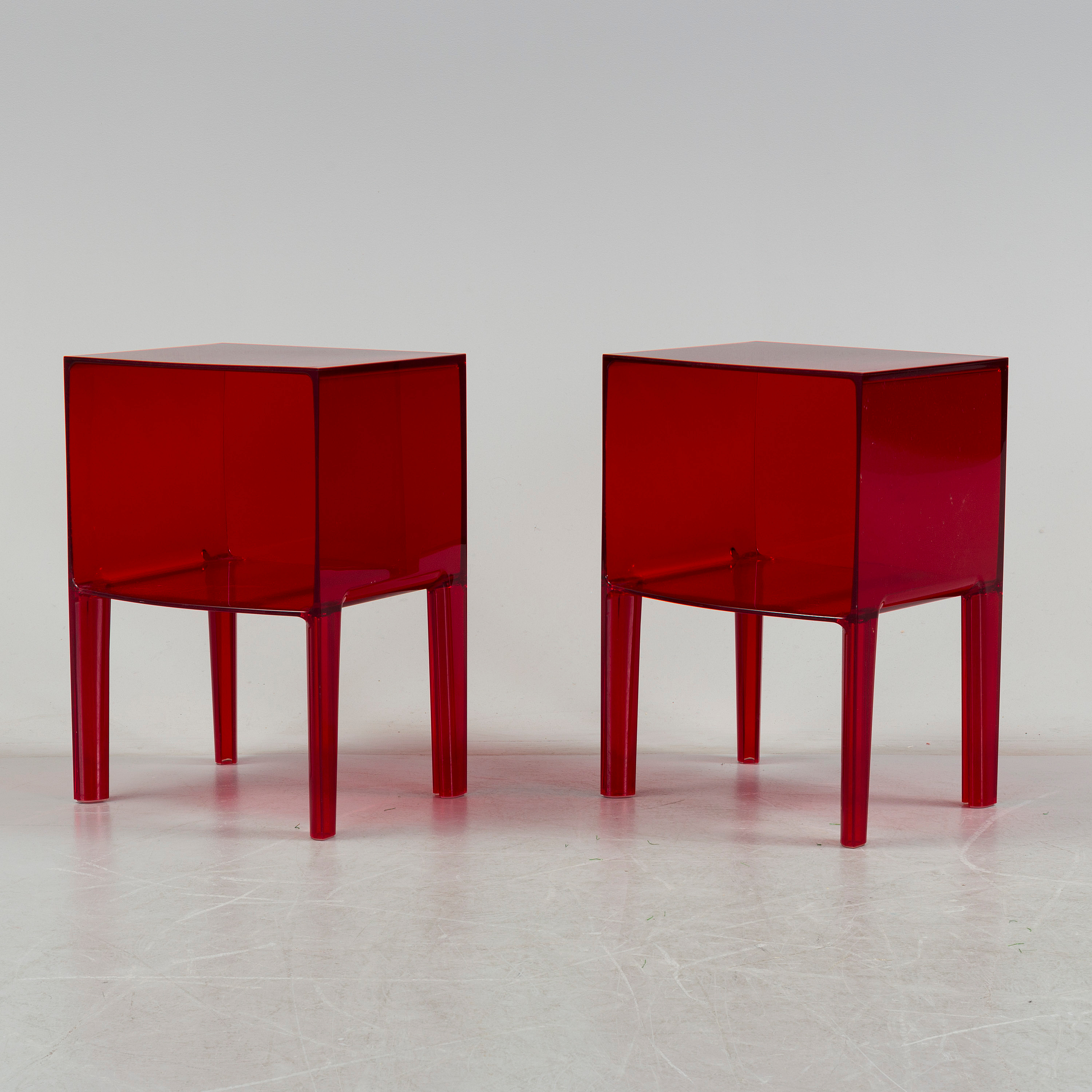 a pair of plastic bedside table \