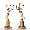 A pair of french empire early 19th century three--light candelabra.
