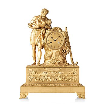 140. A French Empire early 19th century mantel clock.