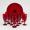 A set of 12 swedish glass champagne flutes and a serving plate by  monica bratt for reijmyre