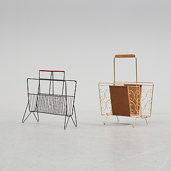 TWO NEWESPAPER STANDS, iron and brass, 1950s.