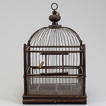 A WOODEN BIRD CAGE, ca 1900.
