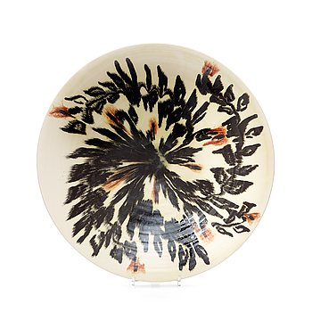 112. JEAN BESNARD, a glazed ceramic charger, France, signed and dated 1925.