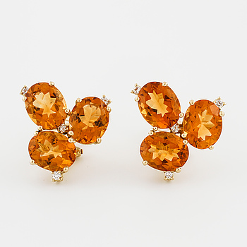 A pair of citrine and brilliant cut diamond earrings.