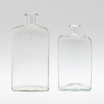 BRÄNNVINSFLASKOR, två stycken, glas, 1800-tal.