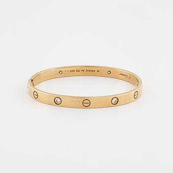CARTIER, Love bracelet med fyra briljantslipade diamanter totalt ca 0.40 ct.
