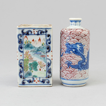 A Chinese underglazed blue and youlihong snuff bottle, and a famille rose vase, early 20th century.